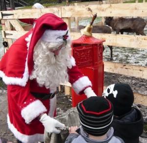 Mini Spotlight members meeting Santa last year
