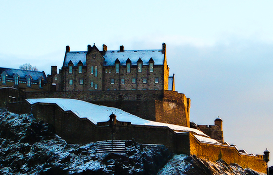 Afternoon sun hits Edinburgh Castle in the snow
