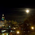 The moon rises over Edinburgh's Light Night