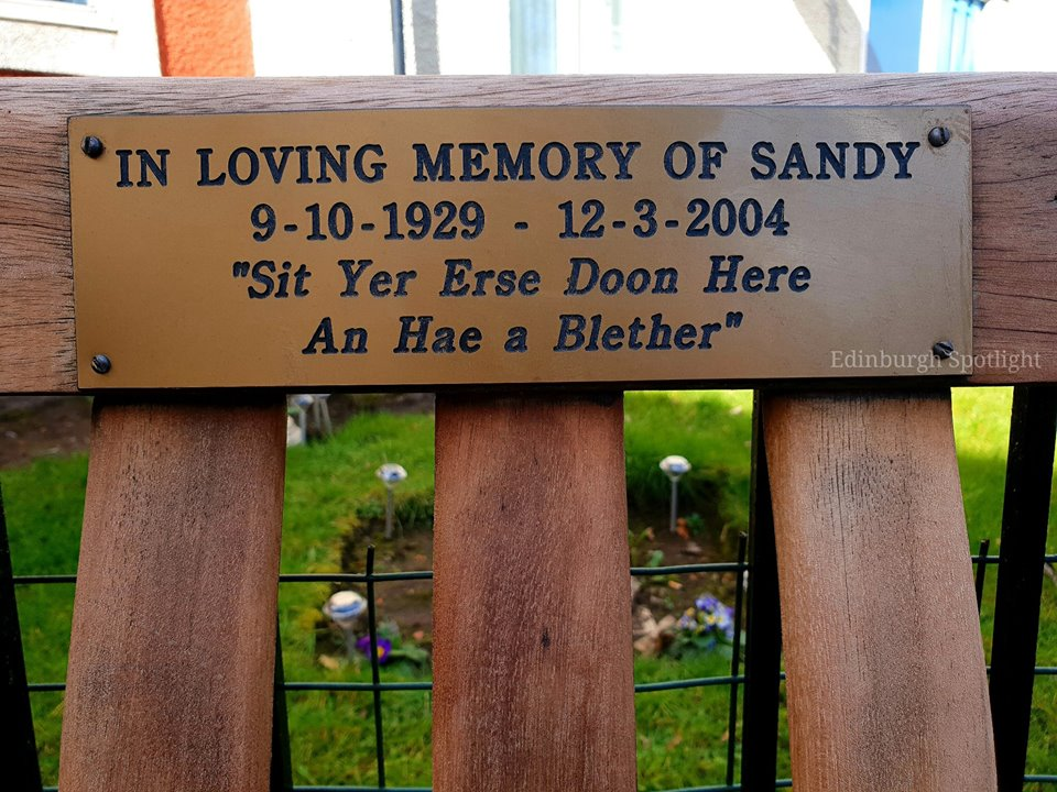 A memorial bench in Stockbridge in memory of Sandy McKenzie.