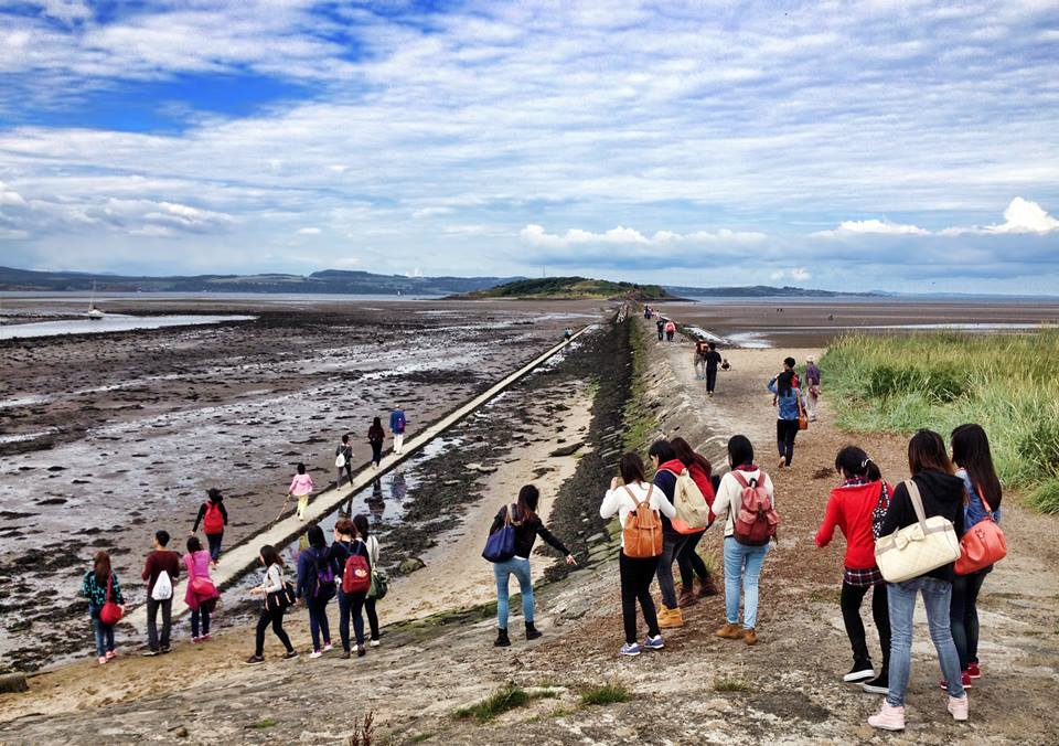 Tourists heading out to explore Cramond Island