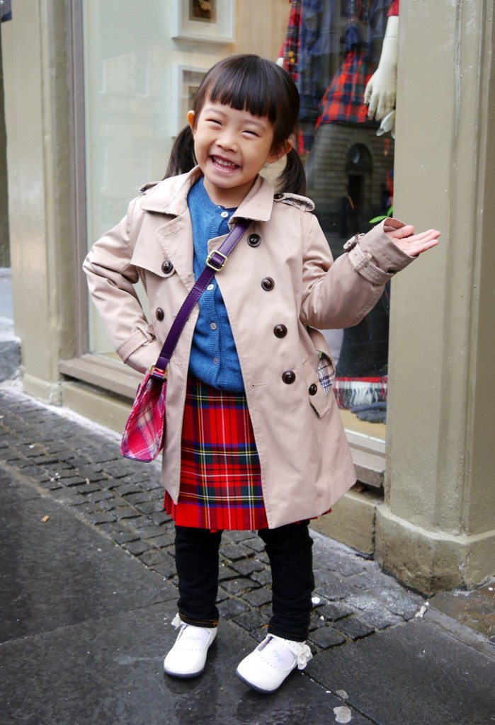 A Chinese girl pleased with her new kilt.