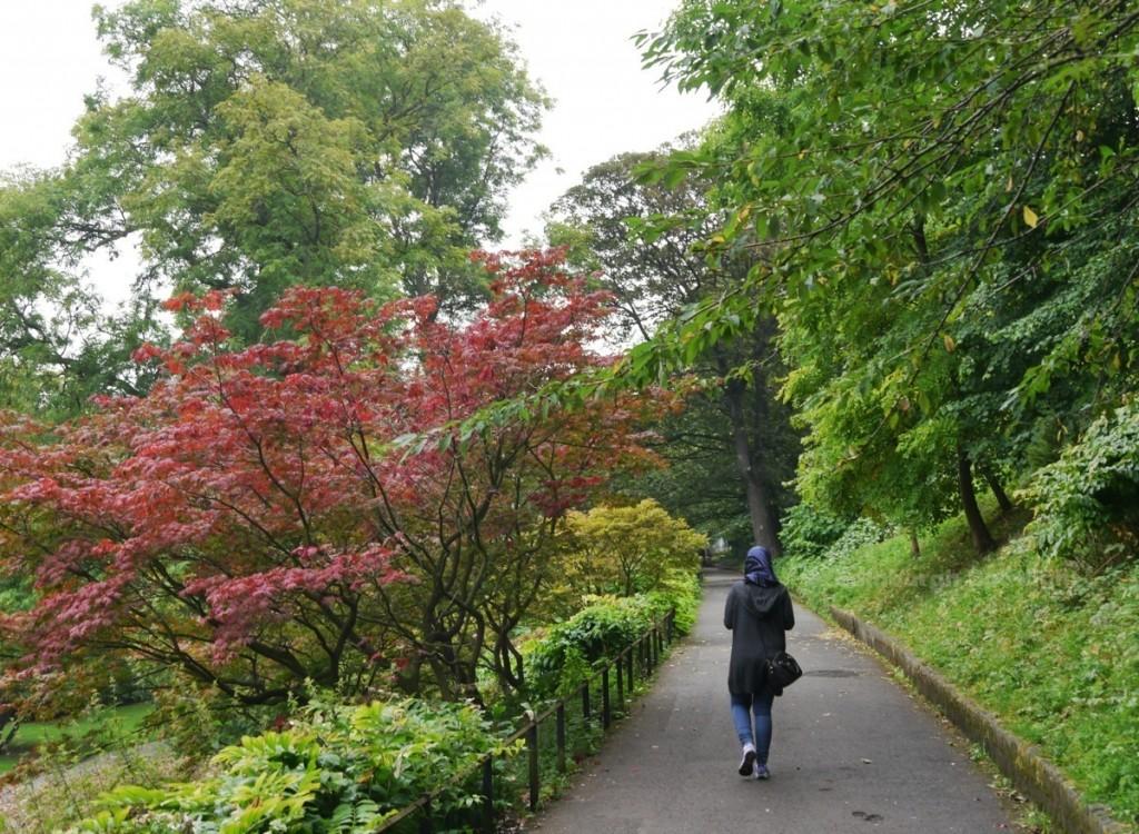 Walking in the rain, Princes Street Gardens
