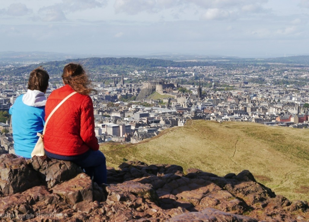 Taking in the views from the summit of Arthur's Seat