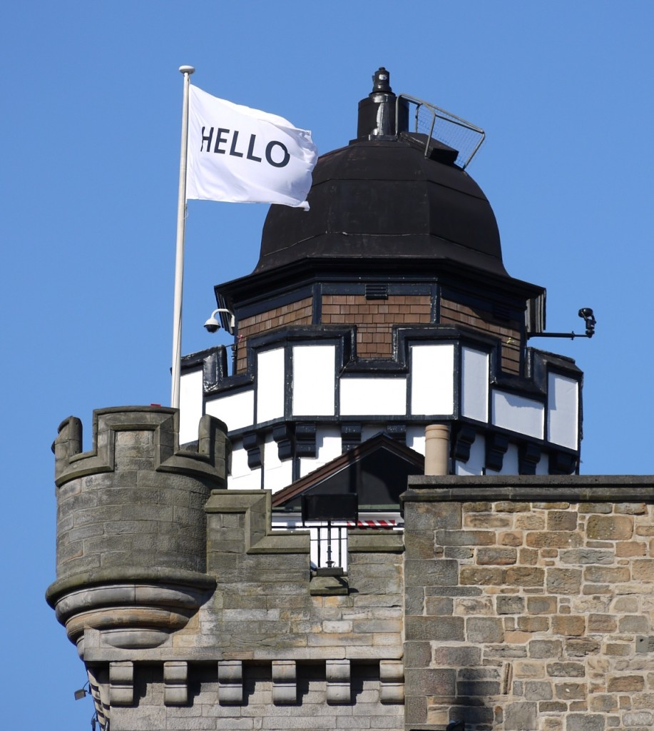 One of the Edinburgh Art Festival's 'Hello' flags flying from the Camera Obscura.