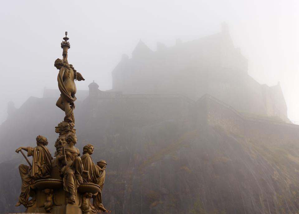 A foggy Edinburgh Castle behind the Ross Fountain