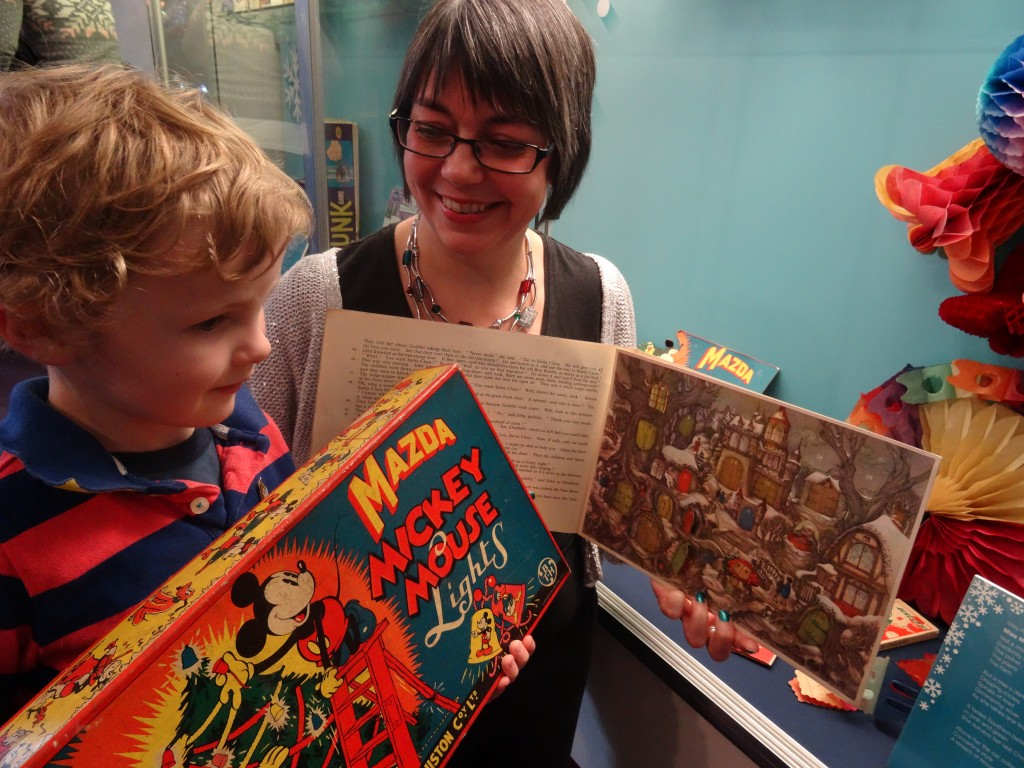 Museum curator Lyn Wall shows Ted Pearce age four what a traditional advent calendar looks like