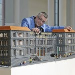 Artist Warren Elsmore with the model of the National Museum of Scotland made from LEGOⓇ Image credit Neil Hanna