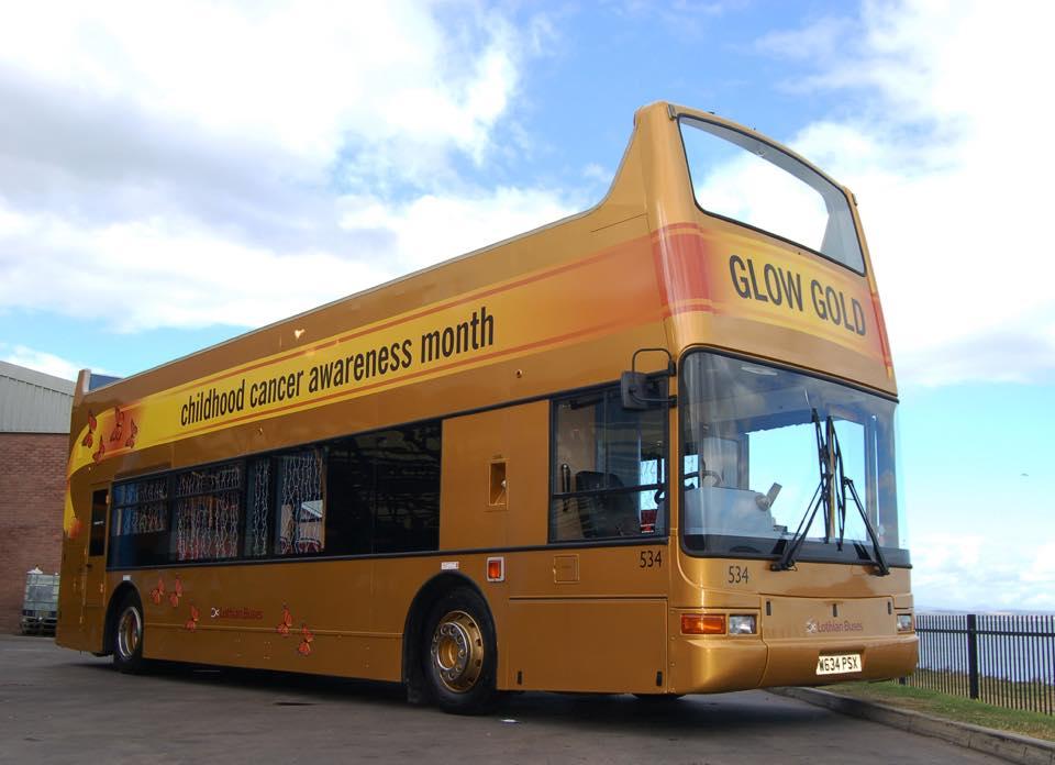 A golden Lothian Bus