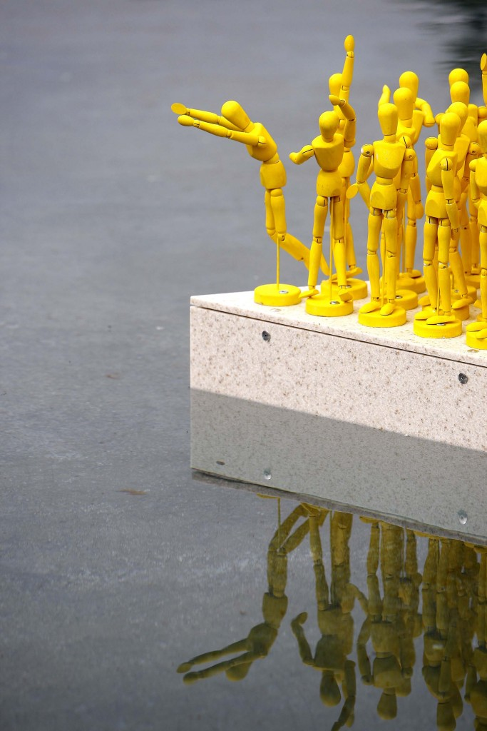 An art installation which celebrates the opening of the 2016 Edinburgh International Festival was unveiled today at the Scottish Parliament. The Anything That Gives Off Light installation was the result of a collaborative project between the Edinburgh International Festival and 1000 school pupils from 22 primary schools across the city. It features 1,000 one feet tall yellow figurines which have been placed on wooden plinths inside the Parliament's ponds. Each figurine was painted by a primary seven school pupil who also created poetry about how light has inspired them. Their poetry will be placed around the perimeter of the ponds. The installation will be exhibited outside the Scottish Parliament until Monday 29 August. 05 August 2016. Pic - Andrew Cowan/Scottish Parliament