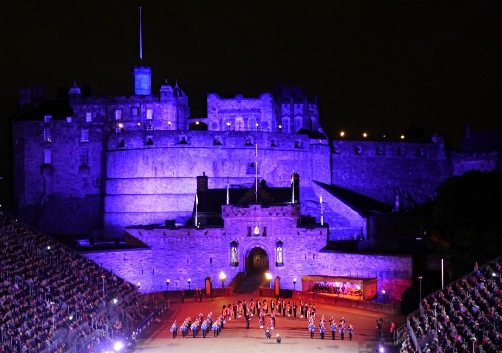A purple Edinburgh Castle during the performance