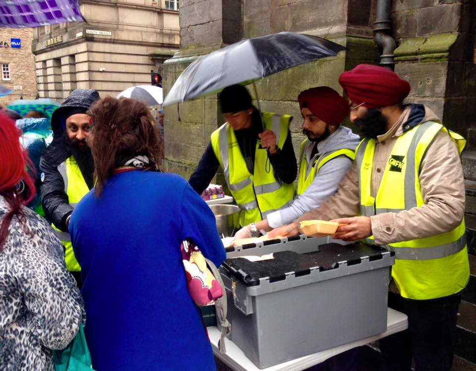 Even in the pouring rain, the Guru Sanak kitchen / Sikh community hand out food every Wednesday in Edinburgh on the Royal Mile.