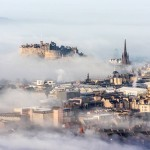 Looking down on a foggy Edinburgh from Arthur's Seat