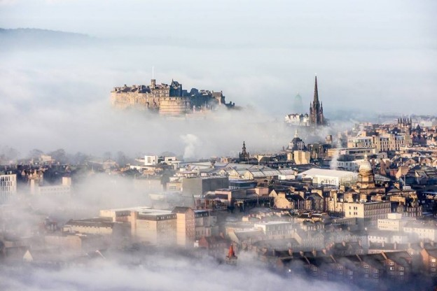 Looking down on a foggy Edinburgh from Arthur's Seat